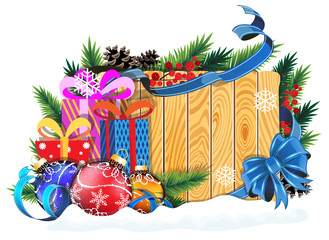 Baubles and Christmas presents on wooden background
