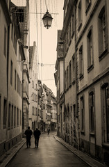 Rainy street in France, vertical, in sepia