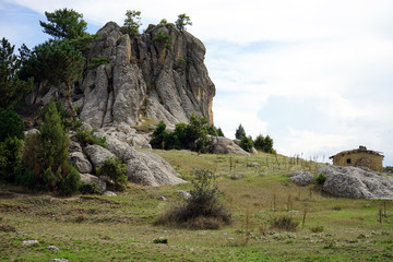 Rock and farmhouse