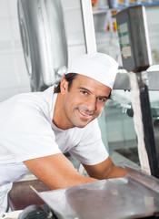 Confident Butcher Working In Butchery
