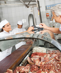 Customer Paying Through Smartphone At Butchery