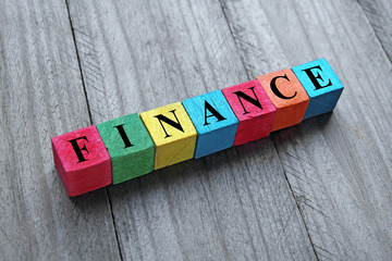 concept of finance word on colorful wooden cubes