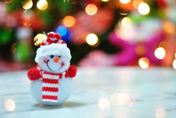 Snowman and de-focused Christmas light