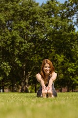 Portrait of a pretty redhead smiling stretching