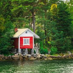 Red Finnish Wooden Bath Sauna Log Cabin On Island In Summer