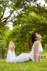 Healthy woman doing stretching exercises at park