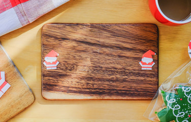 Paper Santa on wooden plate.
