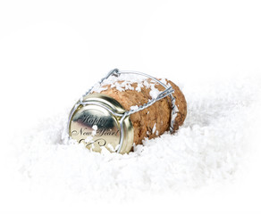Champagne cork in the snow on a white background