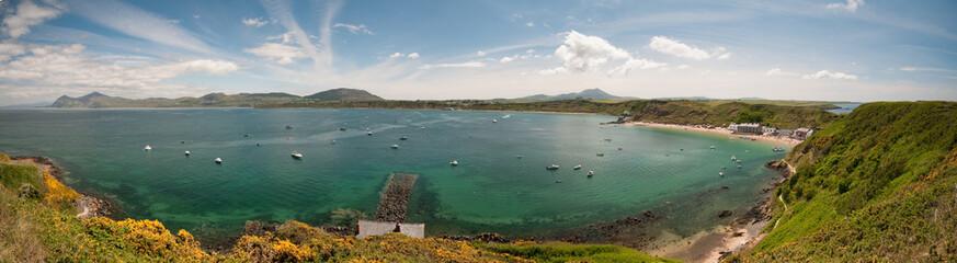 Horse shoe bay blue sky and coastline panorama