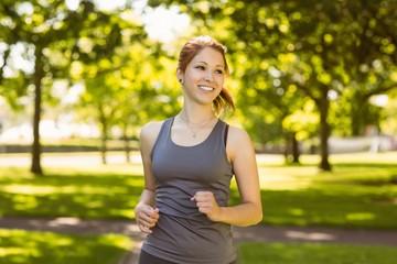 Portrait of a pretty redhead running