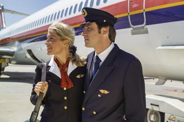 Italy, Sardinia, Olbia Airport, flight assistants near a plane