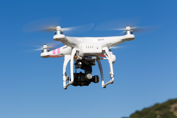 DJI Phantom drone in flight with a mounted GoPro Hero3+ Black Ed