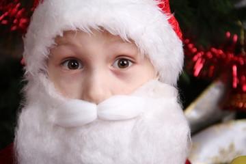 Portrait of a funny boy in Santa Calusa