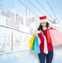 Smiling brunette in winter wear holding shopping bags