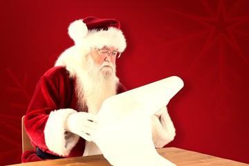 Composite image of santa reads a long list
