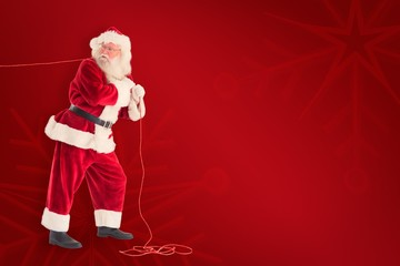 Composite image of santa pushes a shopping cart