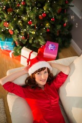 Pretty redhead relaxing on the couch at christmas