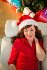 Relaxed redhead lying on the sofa at christmas