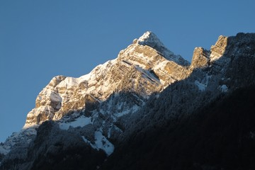 Snow capped mountain at sunrise