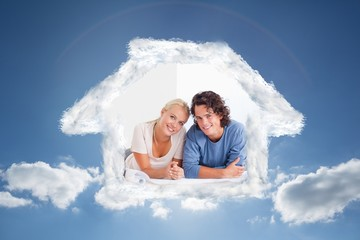 Composite image of cute couple moving in a new house