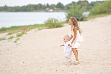 Small Brother and sister in summer nature