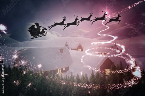 canvas print picture Composite image of silhouette of santa claus and reindeer