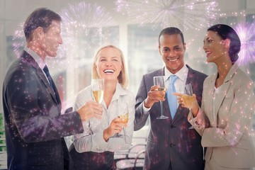 Composite image of business team celebrating with champagne