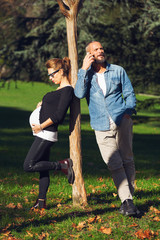 portrait of pregnant woman next to her mate