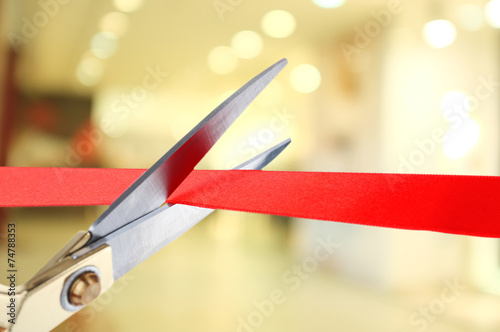 Grand opening, cutting red ribbon - 74788353
