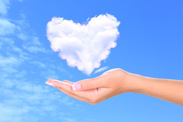 Heart clouds shape floating on hand