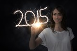 Composite image of businesswoman touching spark