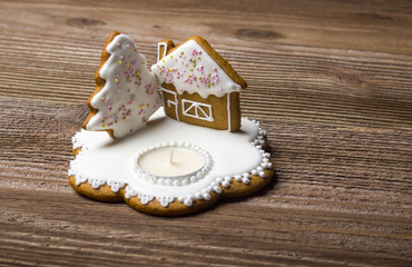 Gingerbread tree with decorated house and candle