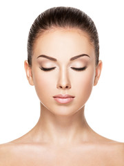 Beautiful face of young woman with closed eyes