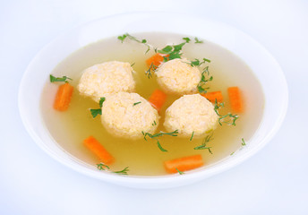 Soup with meatballs in bowl isolated on white