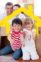 Composite image of family moving house with boxes and thumbs up