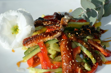 Smoked eel salad decorated in high cuisine style