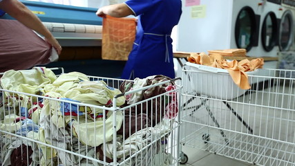 Laundry workers sorting clean linen