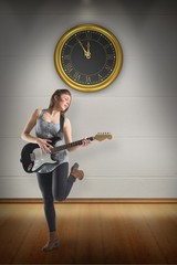 Composite image of pretty young girl playing her guitar