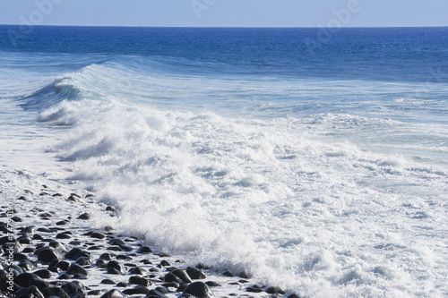 Waves breaking on the shore of Madeira