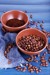 Two bowls of ground coffee and coffee beans