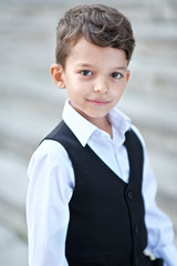 portrait of a little boy in a business style