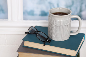 Composition of books, cup and glasses