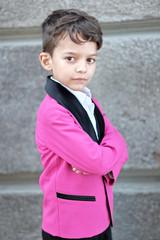portrait of a little boy in a business style
