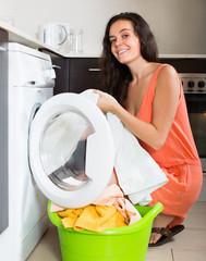 Smiling  woman cheking white clothes