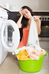 Unhappy  girl doing housework at home