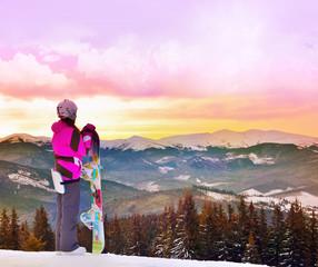 Sport woman in snowy mountains. Carpathian, Ukraine, Europe.