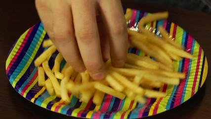 Close-up french fries fast food eating from plate
