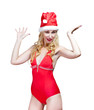 beautiful woman in a bathing suit and  red cap of Santa Claus