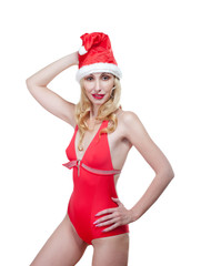 The Snow Maiden. The blonde in a cap of Santa Claus.