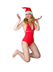 woman in a red bathing suit and a red cap of Santa Claus..